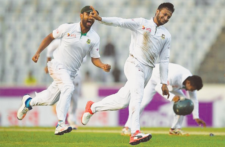 The rejoicing Bangladesh side in their 95th Test