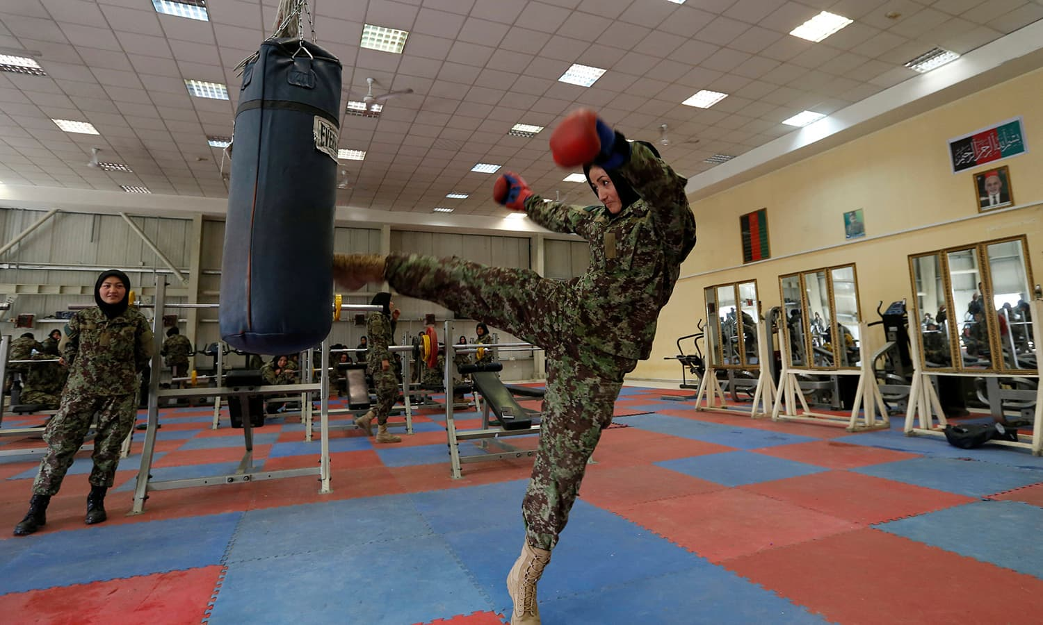 Fatima Rezai, 21, a female officer from the Afghan National Army (ANA) practices with a punch bag during an exercise session at at the Kabul Military Training Centre (KMTC) in Kabul ─Reuters