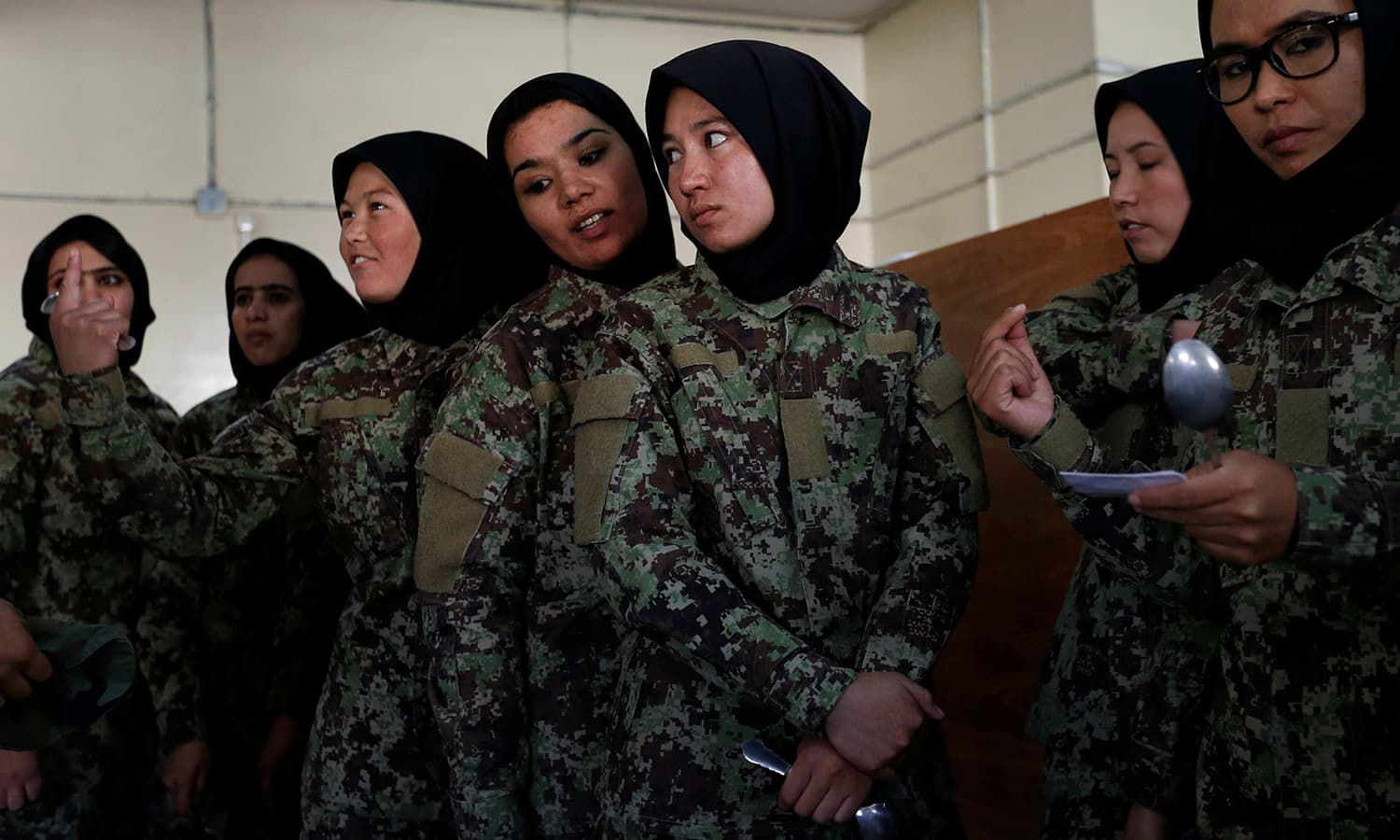 Female soldiers from the Afghan National Army (ANA) wait to get food at the Kabul Military Training Centre (KMTC) in Kabul. ─Reuters