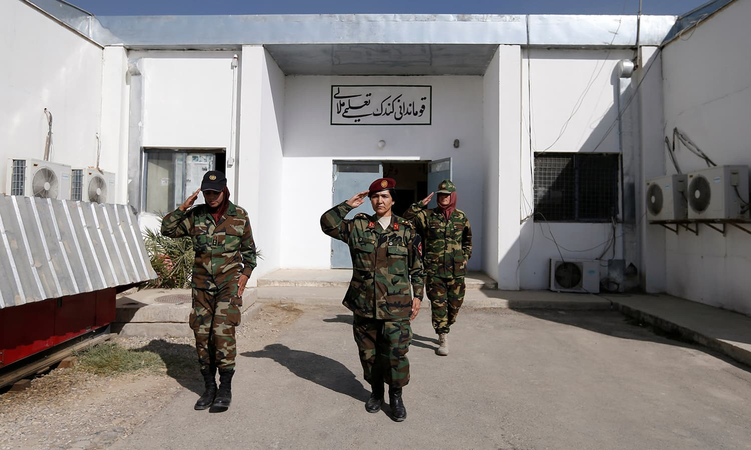 Commander for female Afghan soldiers Lieutenant Colonel Cobra Tanha, 45, leaves her office at the Kabul Military Training Centre (KMTC) in Kabul. ─Reuters