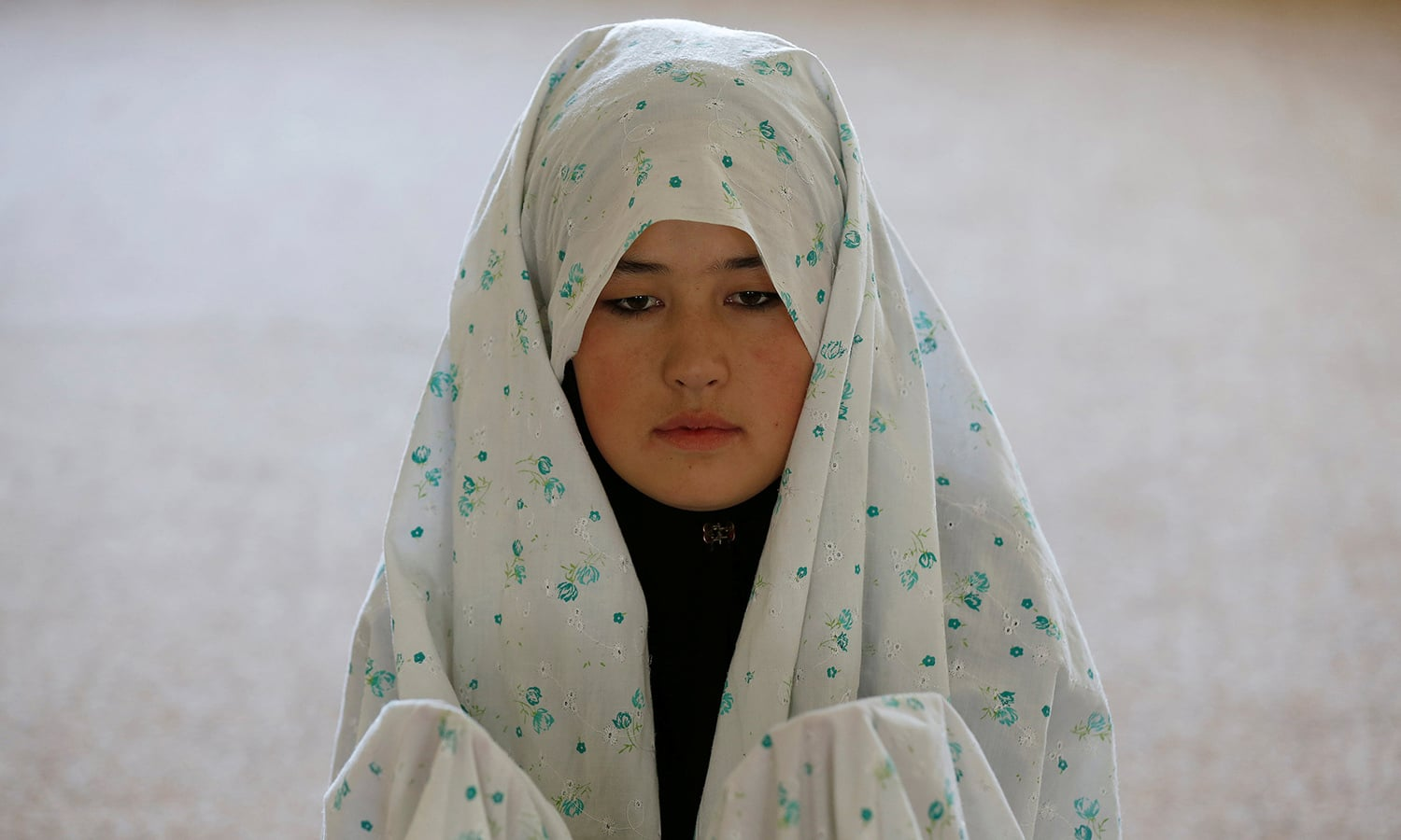 Female soldier Mohazama Najebi, 18, from the Afghan National Army (ANA), prays inside a mosque at the Kabul Military Training Centre (KMTC) in Kabul. ─Reuters