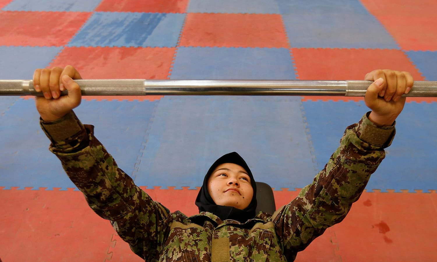 Female soldier, Parwana Naji, 19, from the Afghan National Army (ANA) at the gym at the Kabul Military Training Centre (KMTC) in Kabul─Reuters.