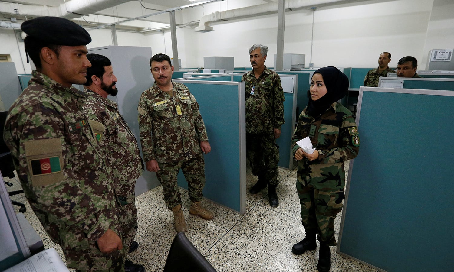 First Lieutenant for the Afghan National Army (ANA), Zainab Baqiri Shayan, 24, speaks with her colleagues in the radio operating department at the Ministry of Defence in Kabul ─Reuters.