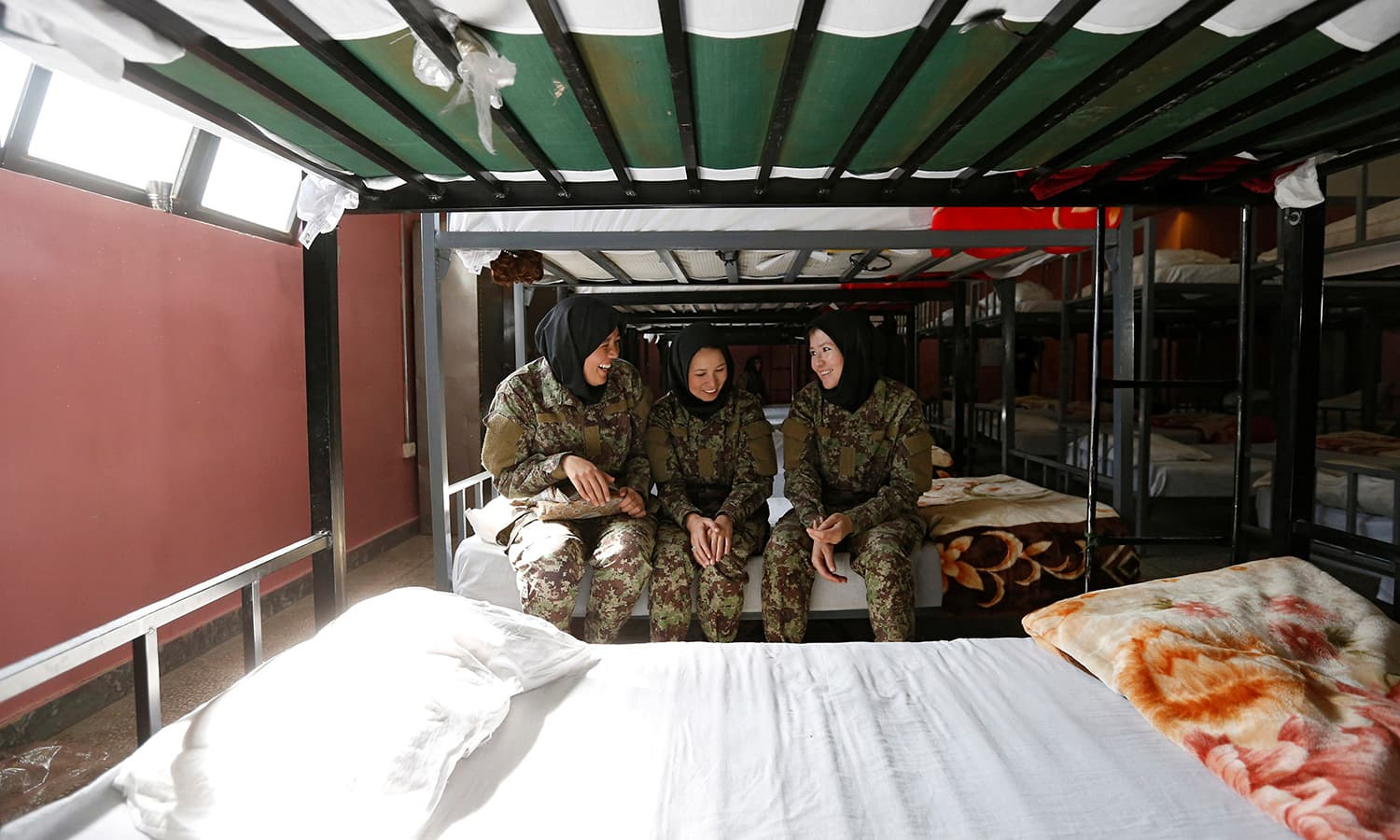 Female soldiers Zarmina Ahmadi, 22 (L), Adela Haidari, 23 (C), and Sabera, 21 (R), from the Afghan National Army (ANA) rest in their barracks at the Kabul Military Training Centre (KMTC) in Kabul─Reuters