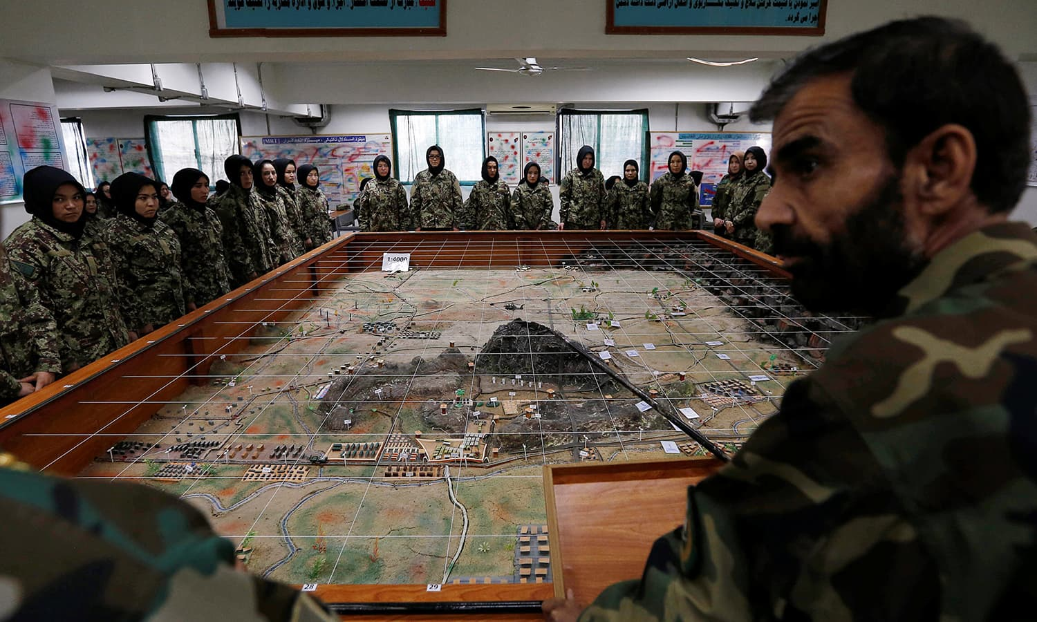 Afghan National Army (ANA) soldiers attend a lesson in a classroom at the Kabul Military Training Centre (KMTC) ─Reuters