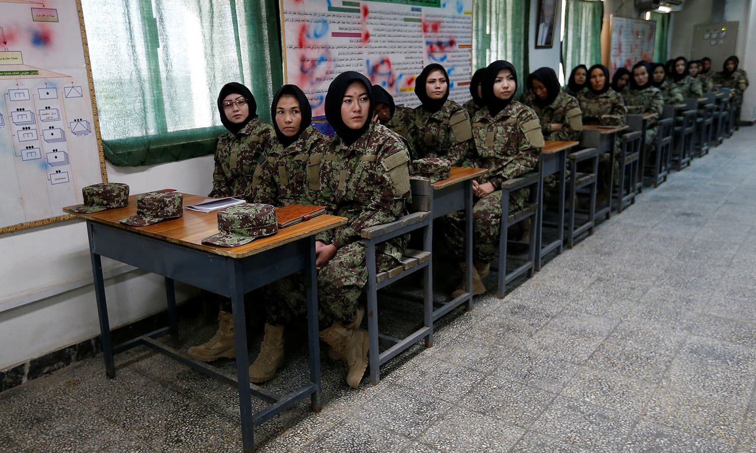 Female soldiers from the Afghan National Army (ANA) attend a lesson in a classroom at the Kabul Military Training Centre (KMTC). ─Reuters