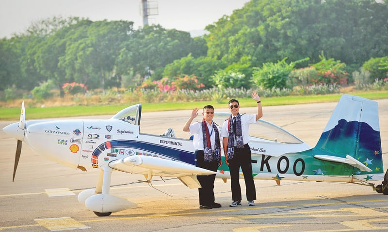 HANK Cheng and co-pilot Thomas Ng Yu Ching (right) pictured soon after landing in Karachi on Friday.—Fahim Siddiqi/White Star
