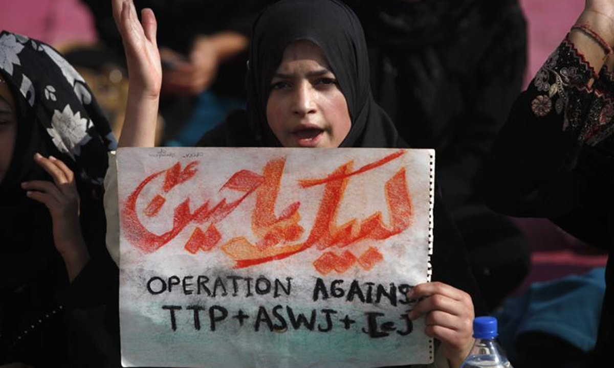 A girl chants a slogan during a protest against Shia killings in Karachi in January, 2014 | Reuters