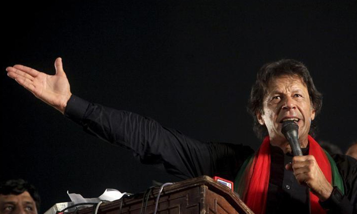 Imran Khan addresses his supporters during a by-election campaign rally in Lahore | Reuters