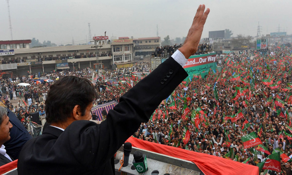 Imran Khan addresses a protest rally in Peshawar in 2013 | AFP