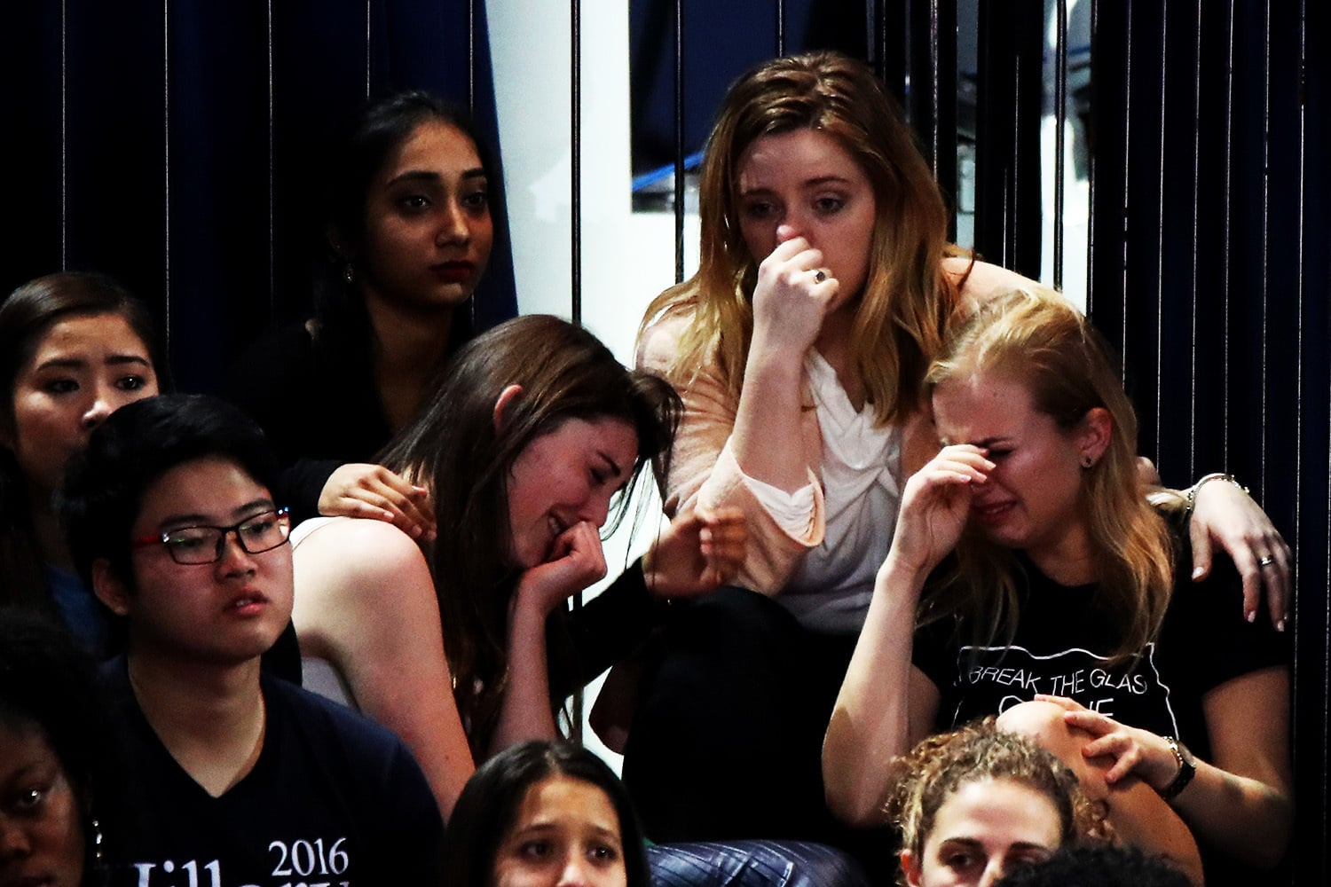 A group of women react as voting results come in at Hillary Clinton's election night event.—AFP
