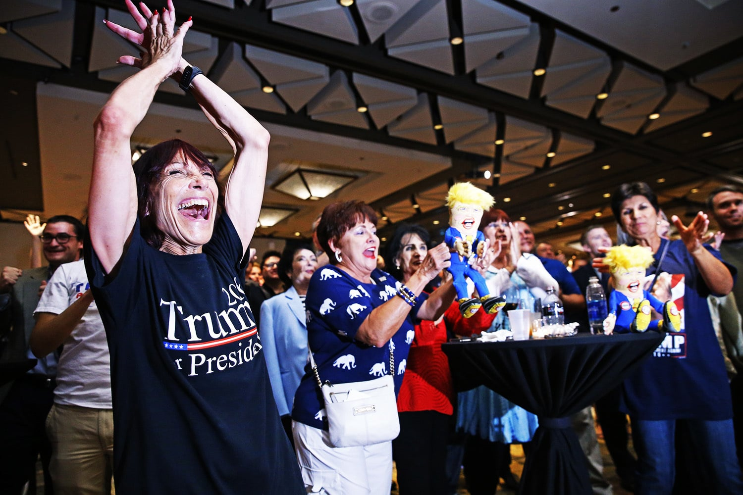 Supporters for Republican presidential candidate Donald Trump react as early results come in.— AP