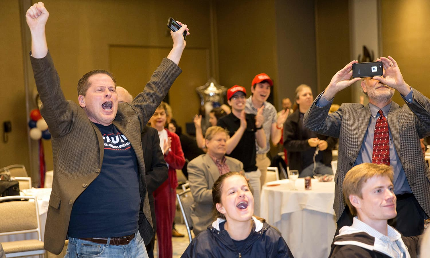 Attendees celebrate election returns during a Republican watch party in Dallas, Texas.— AFP