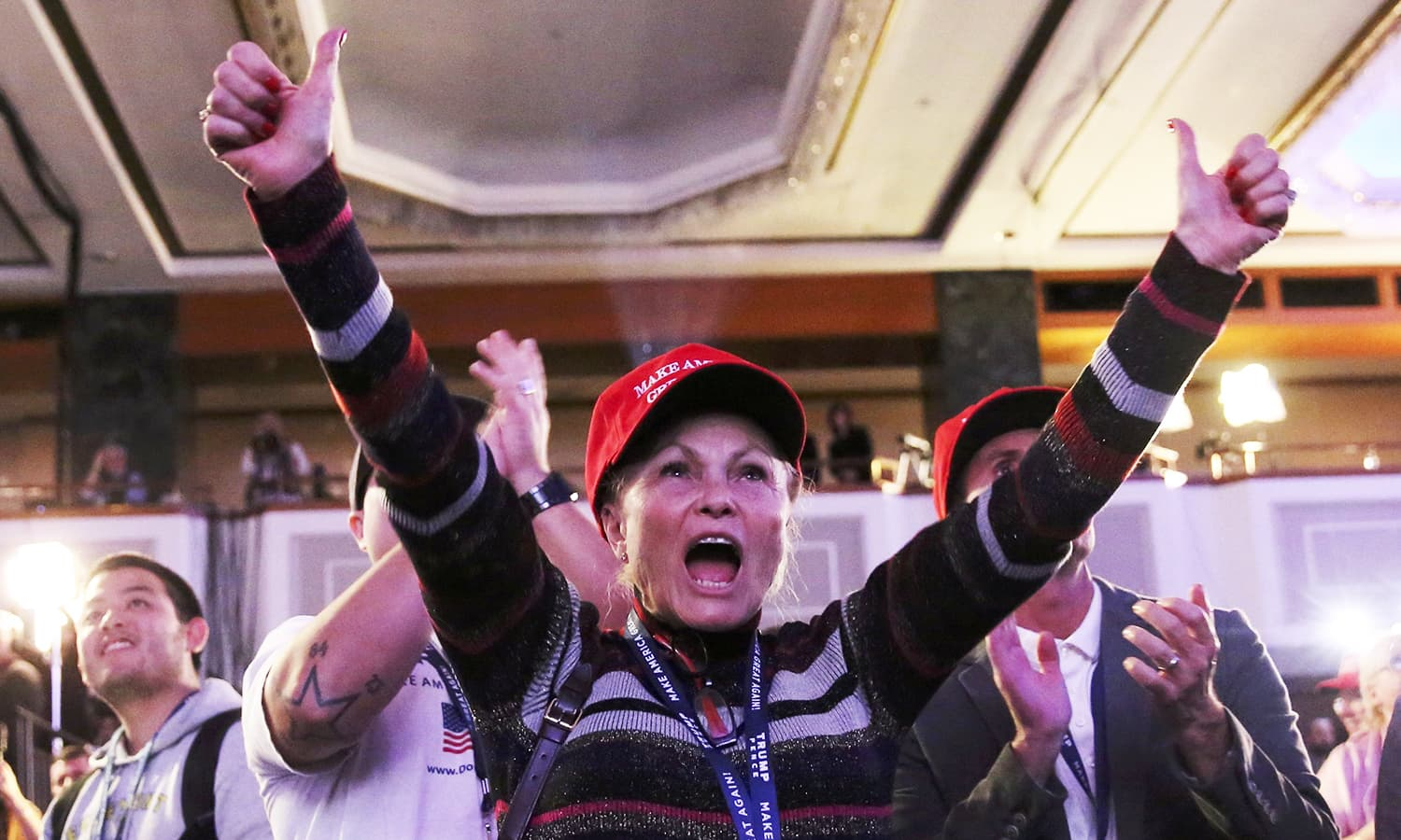 Supporters of Donald Trump celebrate the results from Ohio and Florida at his election night rally in Manhattan.—Reuters