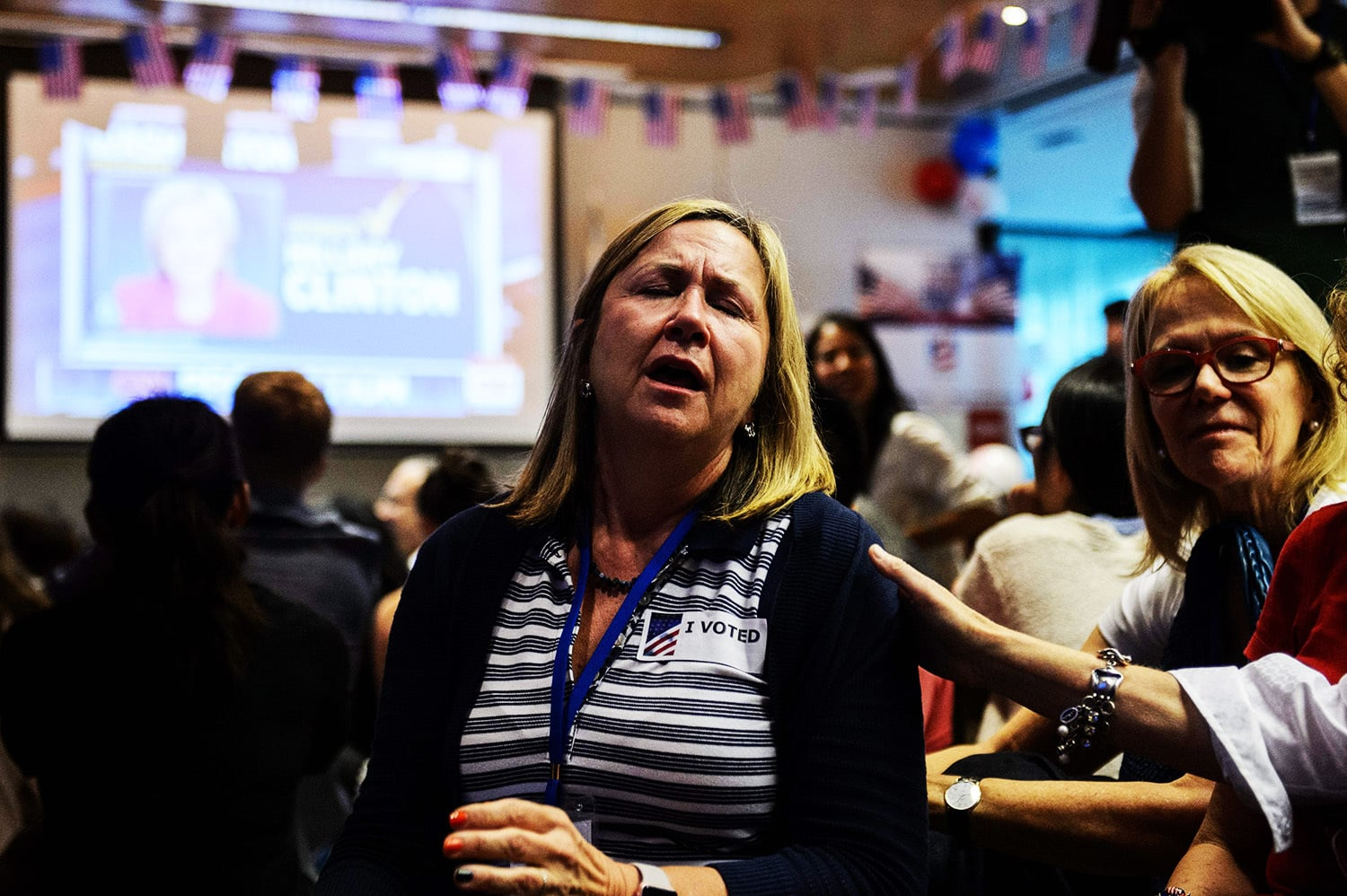 Supporters of Hillary Clinton react as they watch live coverage of the US elections.—AFP