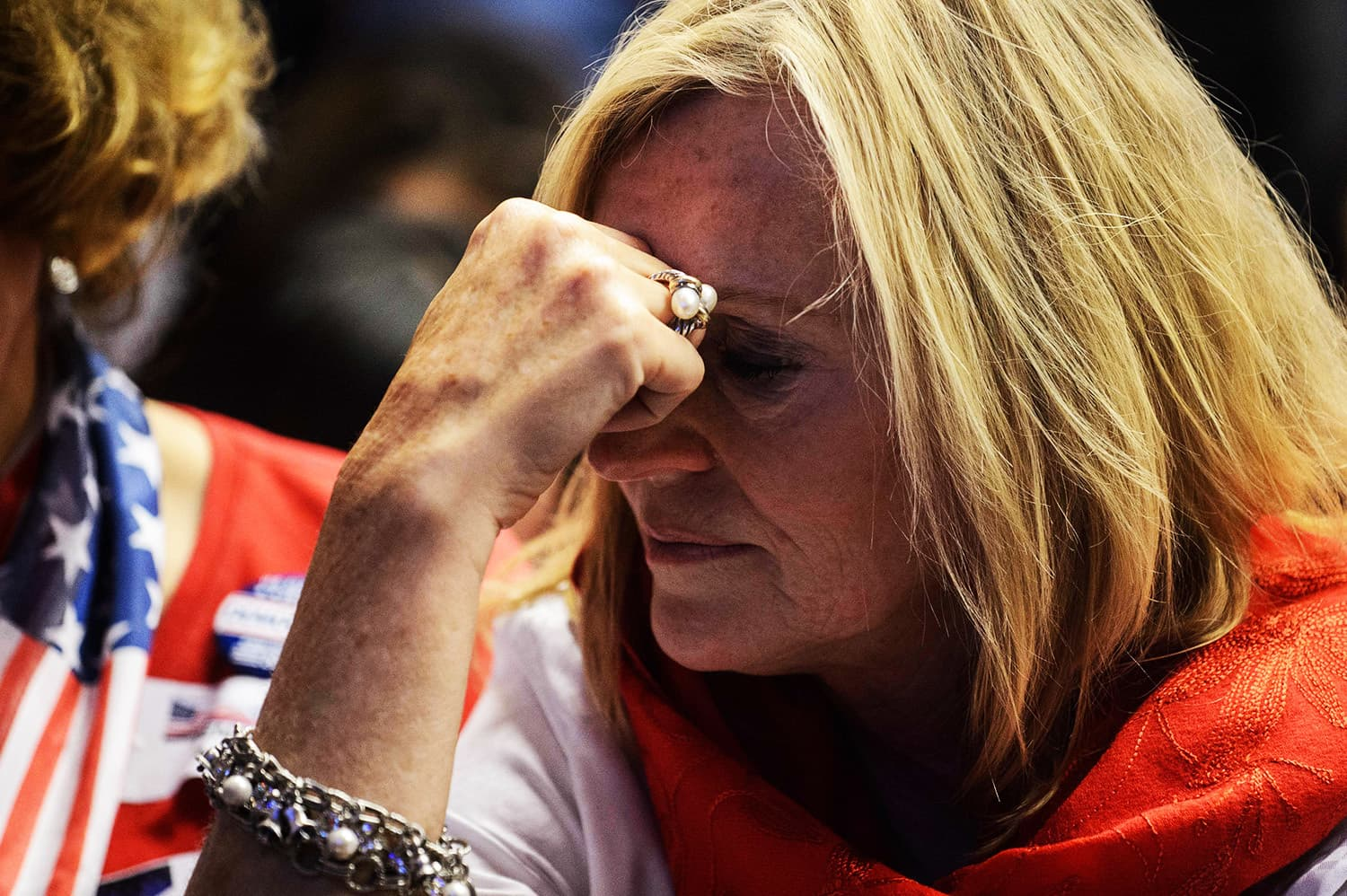 A supporter of Hillary Clinton reacts as she watches live coverage of the US elections.—AFP