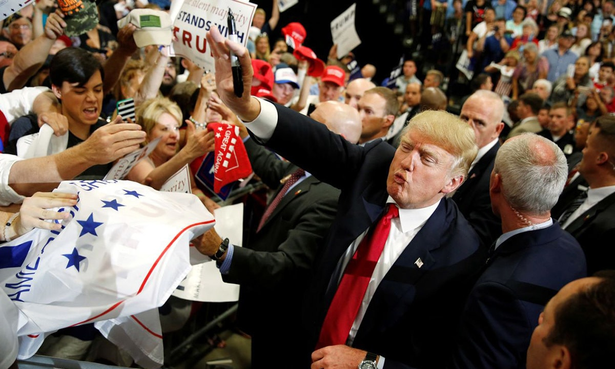 Donald Trump waves to supporters during a campaign rally in Albuquerque, New Mexico | Reuters
