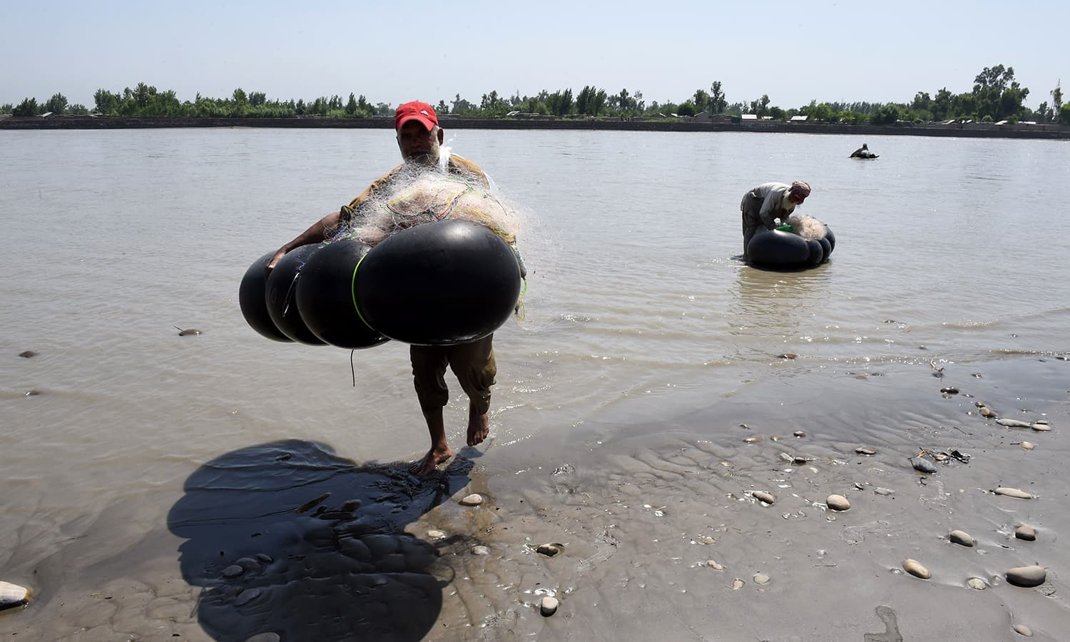 Dynamite And Generators Pakistani Fishermen Stun Fish Risk Lives Wiring A House For Generator Carry Their Nets Tubes After Catching From The River Kabul At