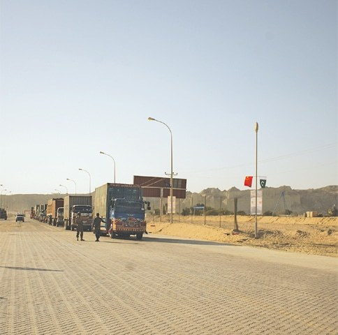 A convoy of trucks pictured near the Gwadar port on Saturday. ─ Photo by author