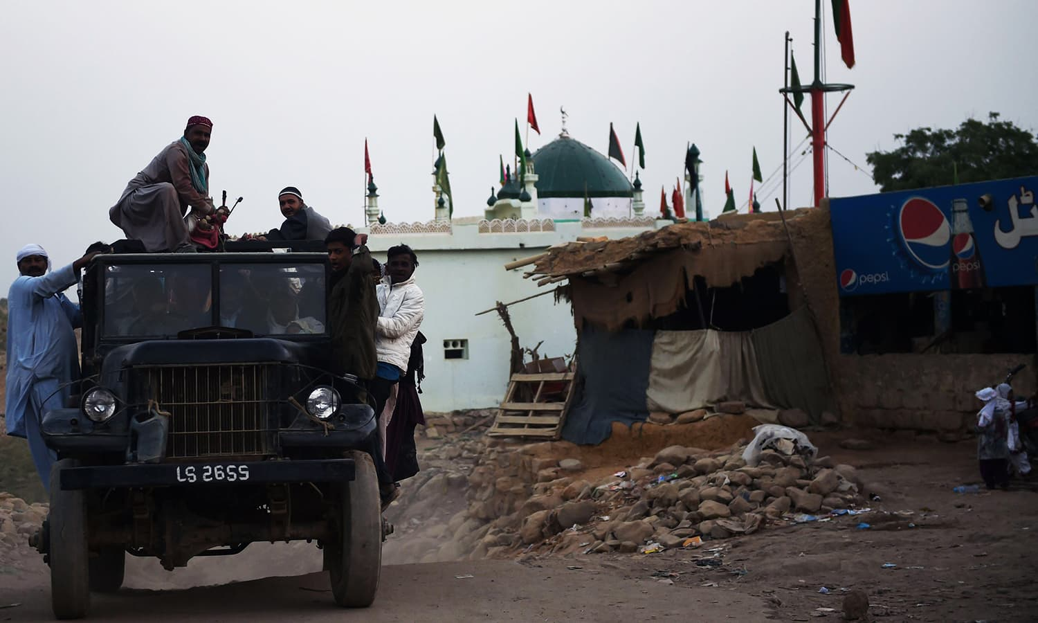 Devotees board a jeep on their return home from the shrine of Sufi saint Shah Noorani after the bomb blast. ─ AFP