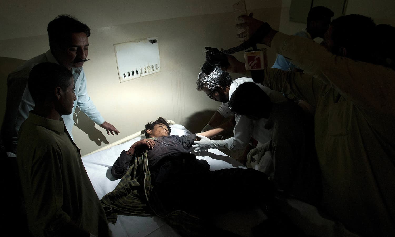 An injured boy victim of the bomb blast at a Sufi shrine is treated at a local hospital in Hub. ─ AP