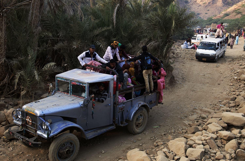 People head back home following the bomb blast. ─ AP