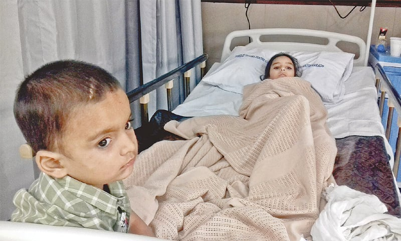 Malaika and Afzal, who lost their mother and youngest sibling in the shrine attack, are under treatment at the Civil Hospital on Sunday.—Fahim Siddiqi / White Star