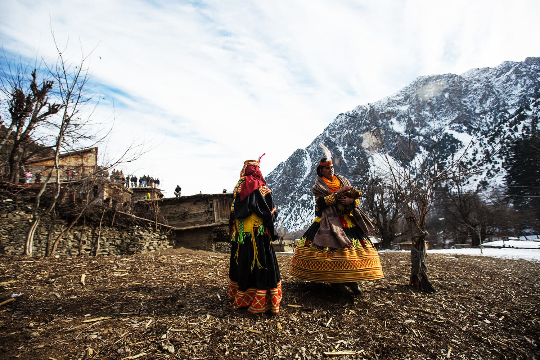 Women walk in traditional dresses