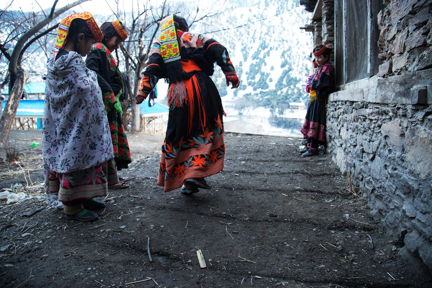 Girls play a traditional game on a street
