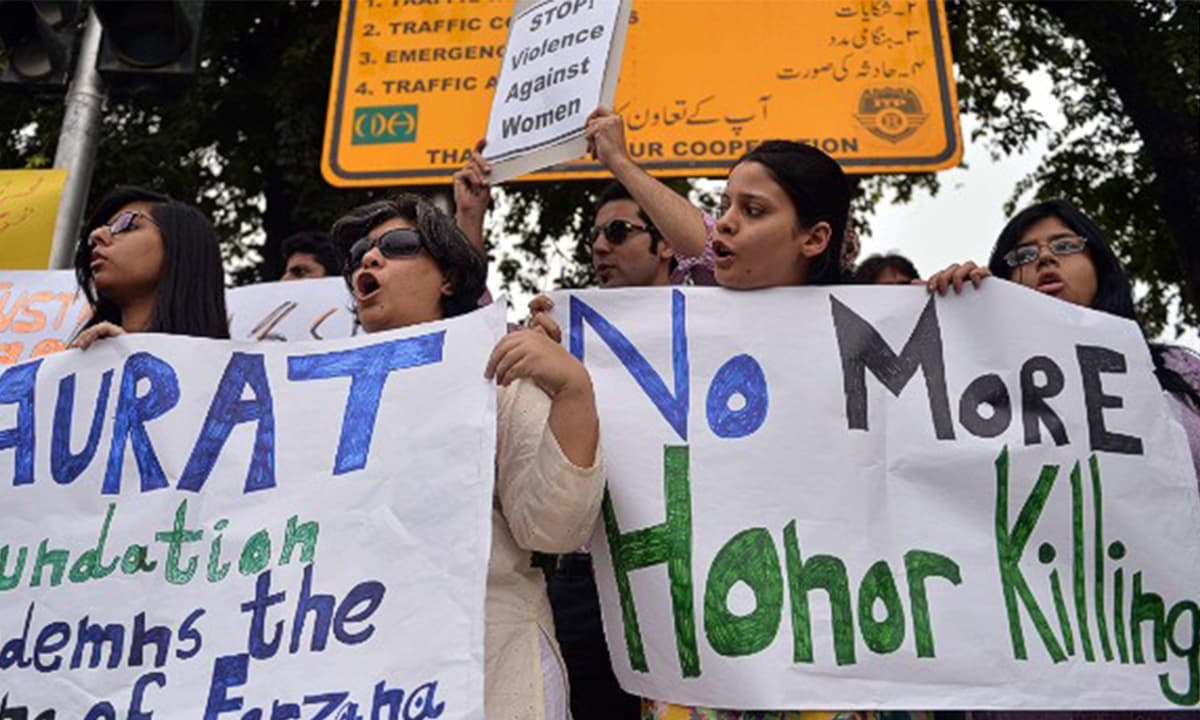 Women hold placards in a protest against honour killings | AFP