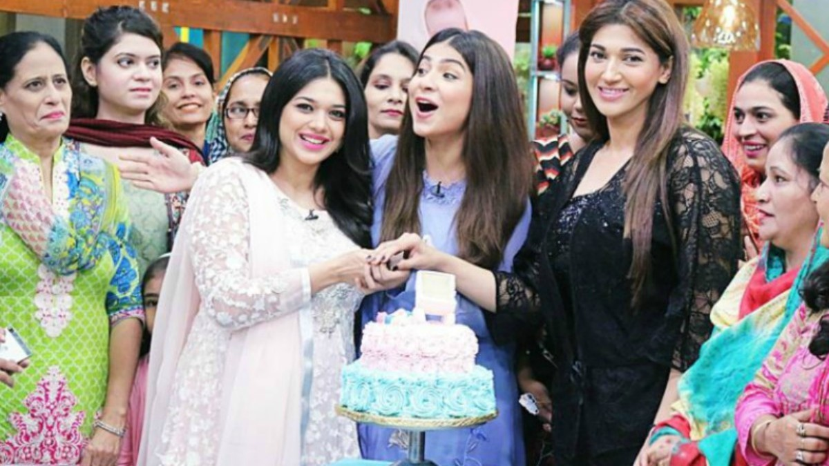 Sanam Jung cuts a cake with celebrity guests Dua Malik and Sana at her Jago Pakistan Jago baby shower
