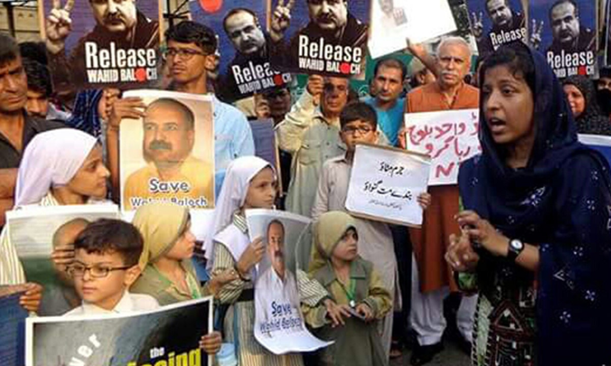 Abdul Wahid Baloch's daughter, Hani (far right), at a protest in Karachi | Courtesy Wahid's family