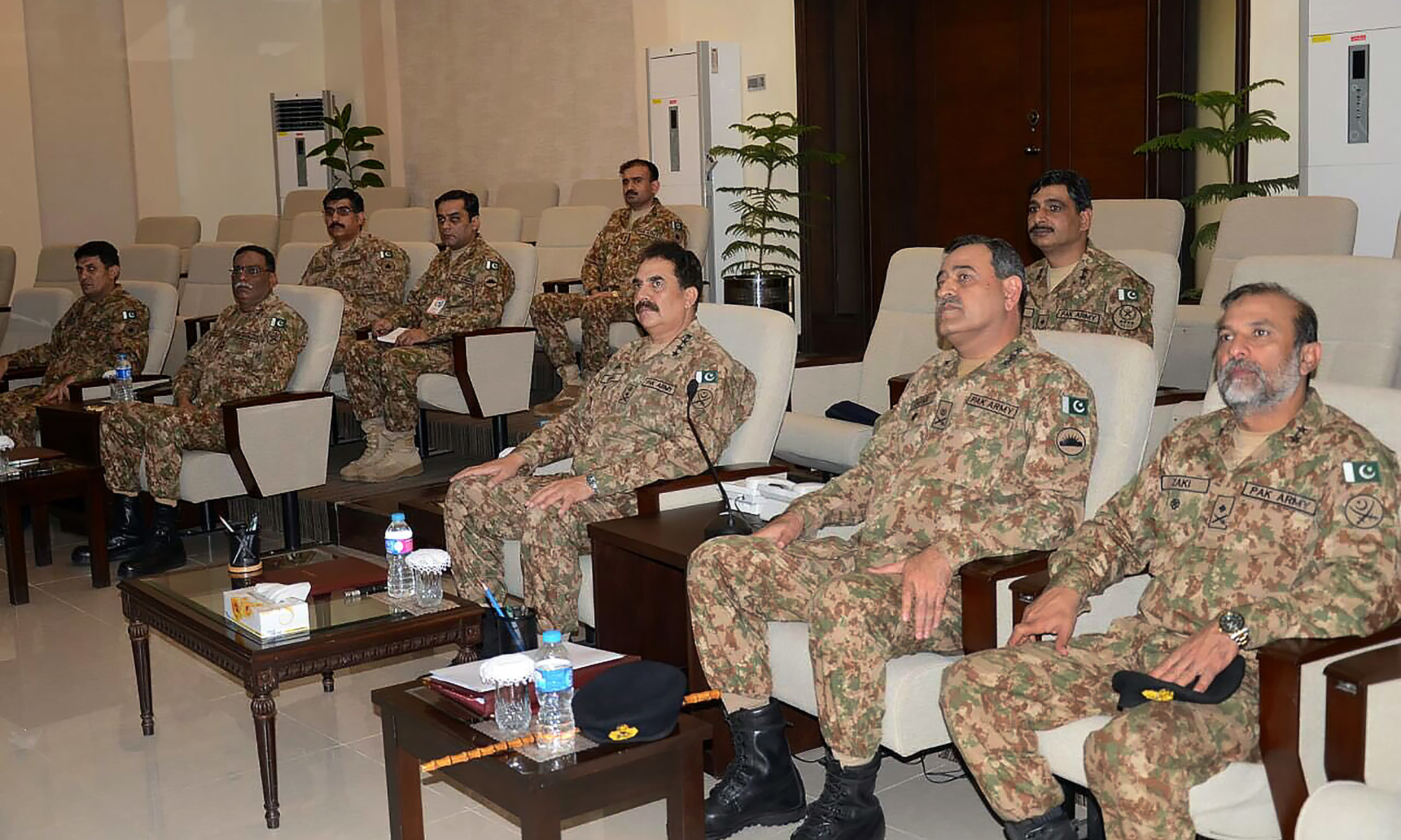 Gen Raheel Sharif listens during a briefing on the situation at LoC. —AFP