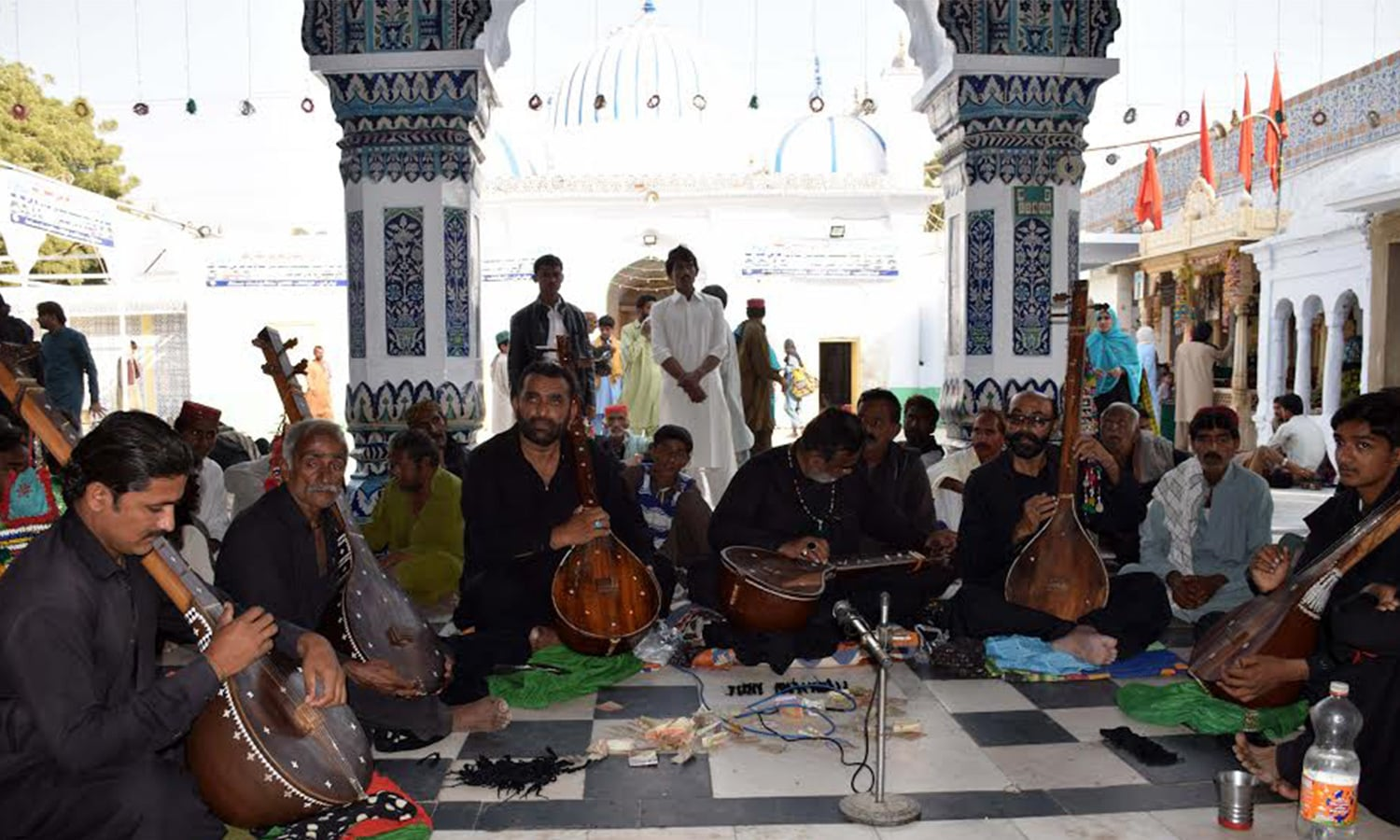 Saint's faqirs who are dressed in black sit on semi circle formation and use the long instrument called 'dhambora' to recite Bhitai's poetry which is called 'wai'.
