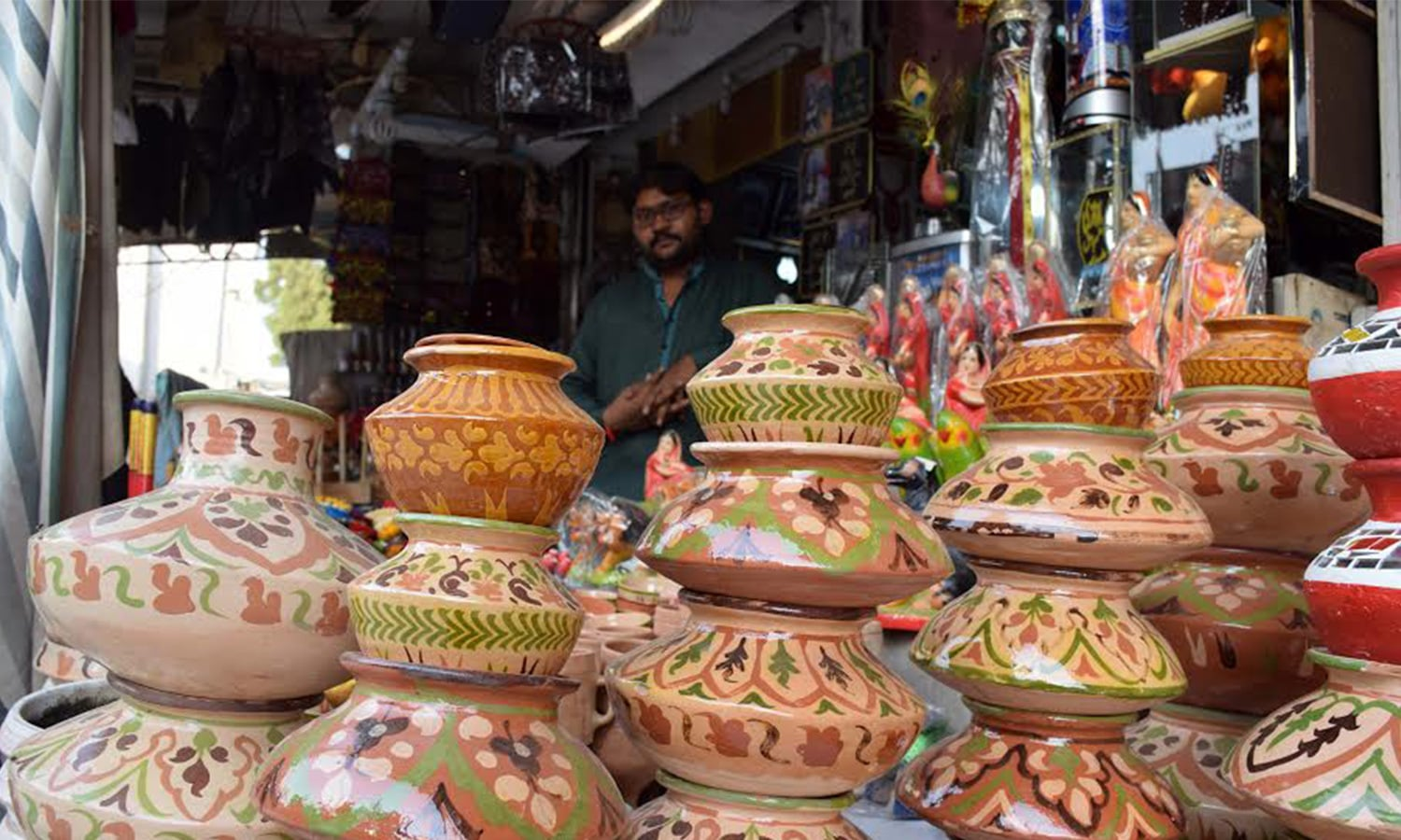 Shopkeepers selling local sweets, pots and dolls adorn their shops with colourful buntings.