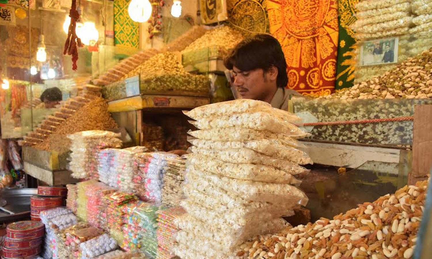 Shopkeepers selling local sweets, dry fruits adorn their shops with colourful buntings.