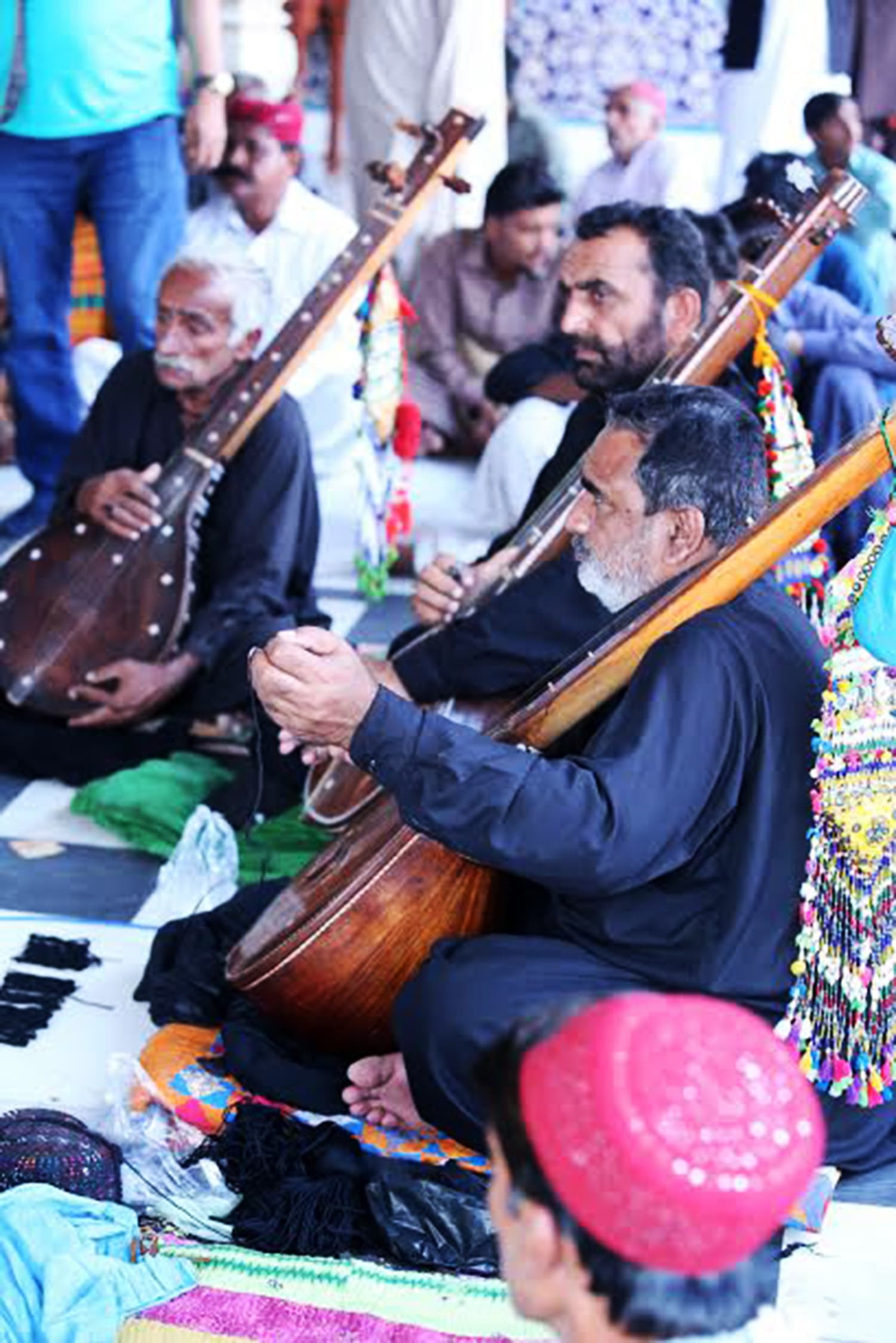 Saint's faqirs use the long instrument called 'dhambora' to recite Bhitai's poetry.