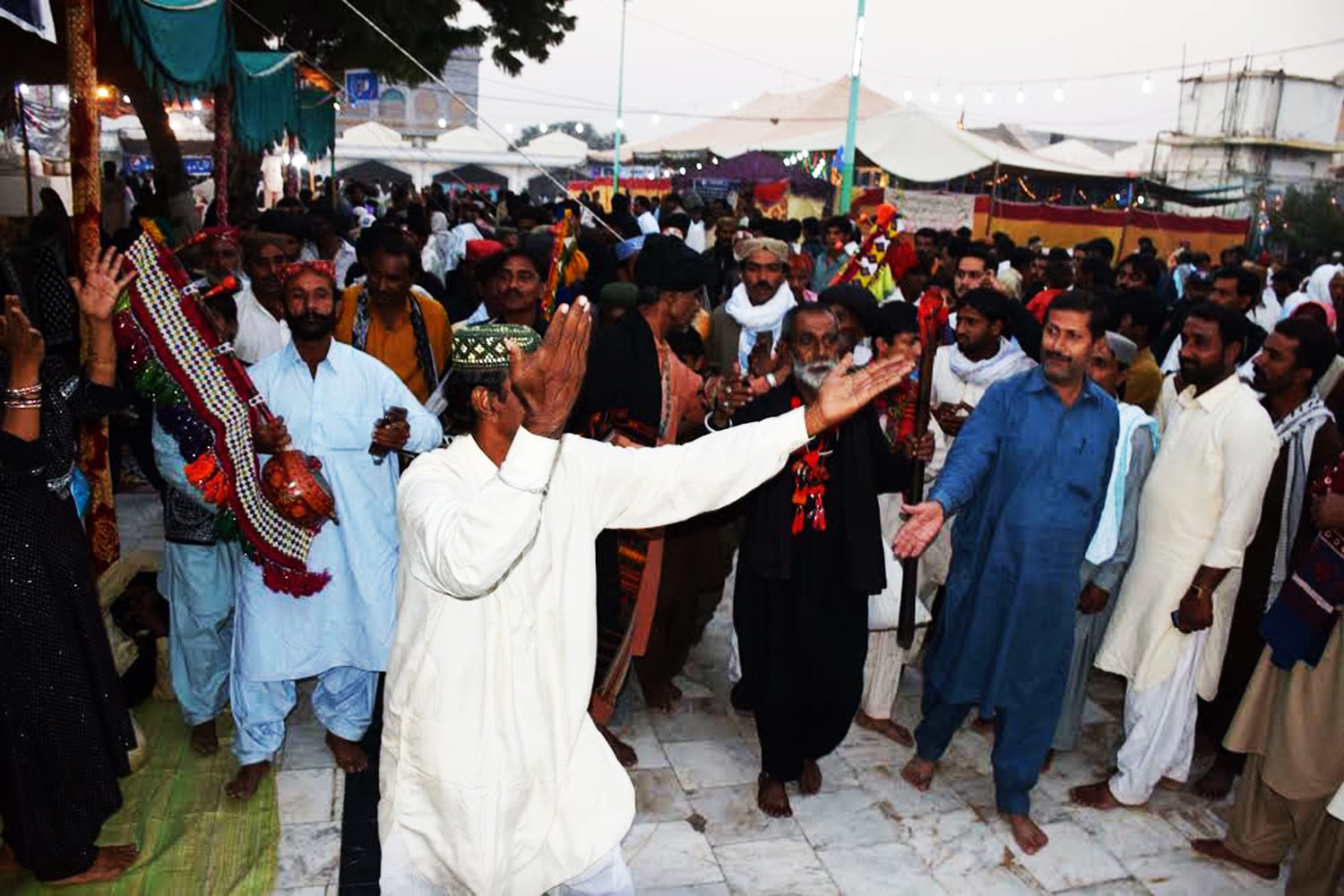 Devotees enter shrine while reciting mystic poetry of great sufi saint.