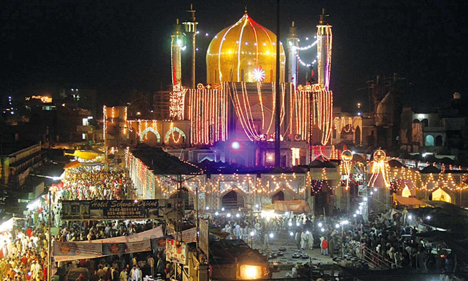 Devotees and pilgrims throng at the shrine of a famous Sufi saint in the Sindh city of Shewan.