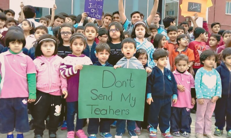 PESHAWAR: Students of Pak-Turk Schools hold a demonstration outside their school in Hayatabad on Wednesday to protest against expulsion of their Turkish teachers from Pakistan.— Dawn