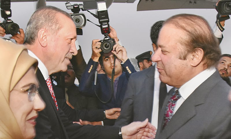 Prime Minister Nawaz Sharif warmly receives Turkish President Recep Tayyip Erdogan upon his arrival at the Nur Khan Airbase on Wednesday.— APP