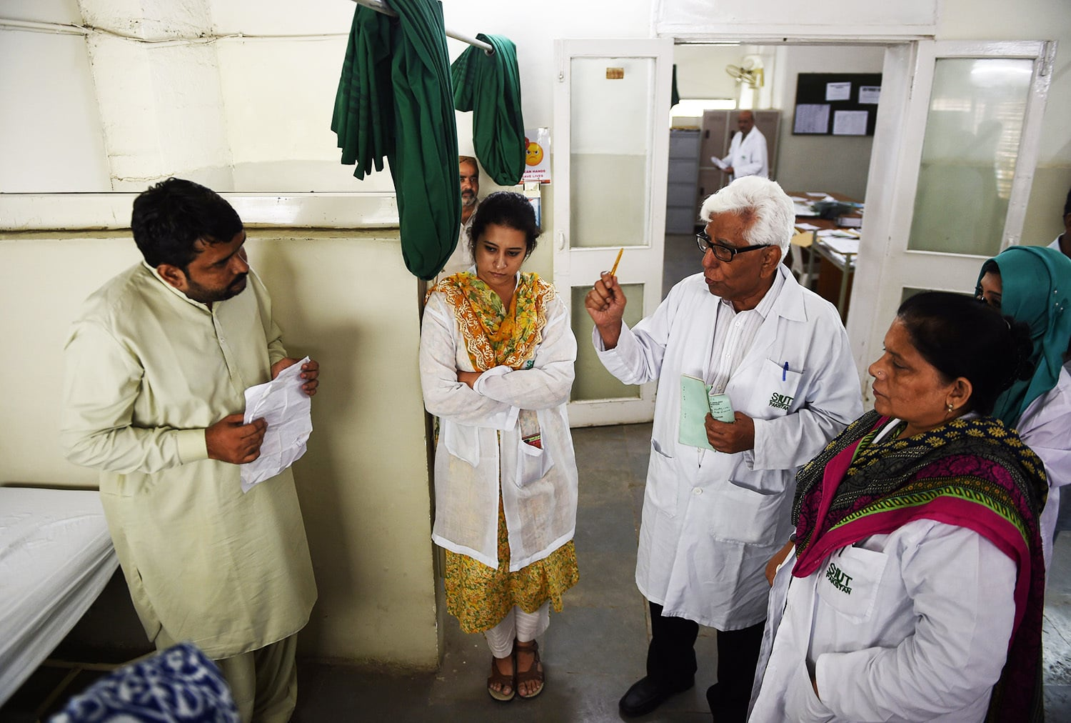 Adib Rizvi speaks to patients and carers in Karachi.—AFP
