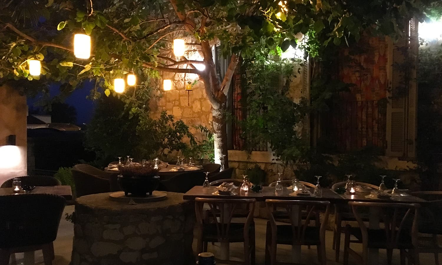 A beautifully lit courtyard at Cafe Agrilia.