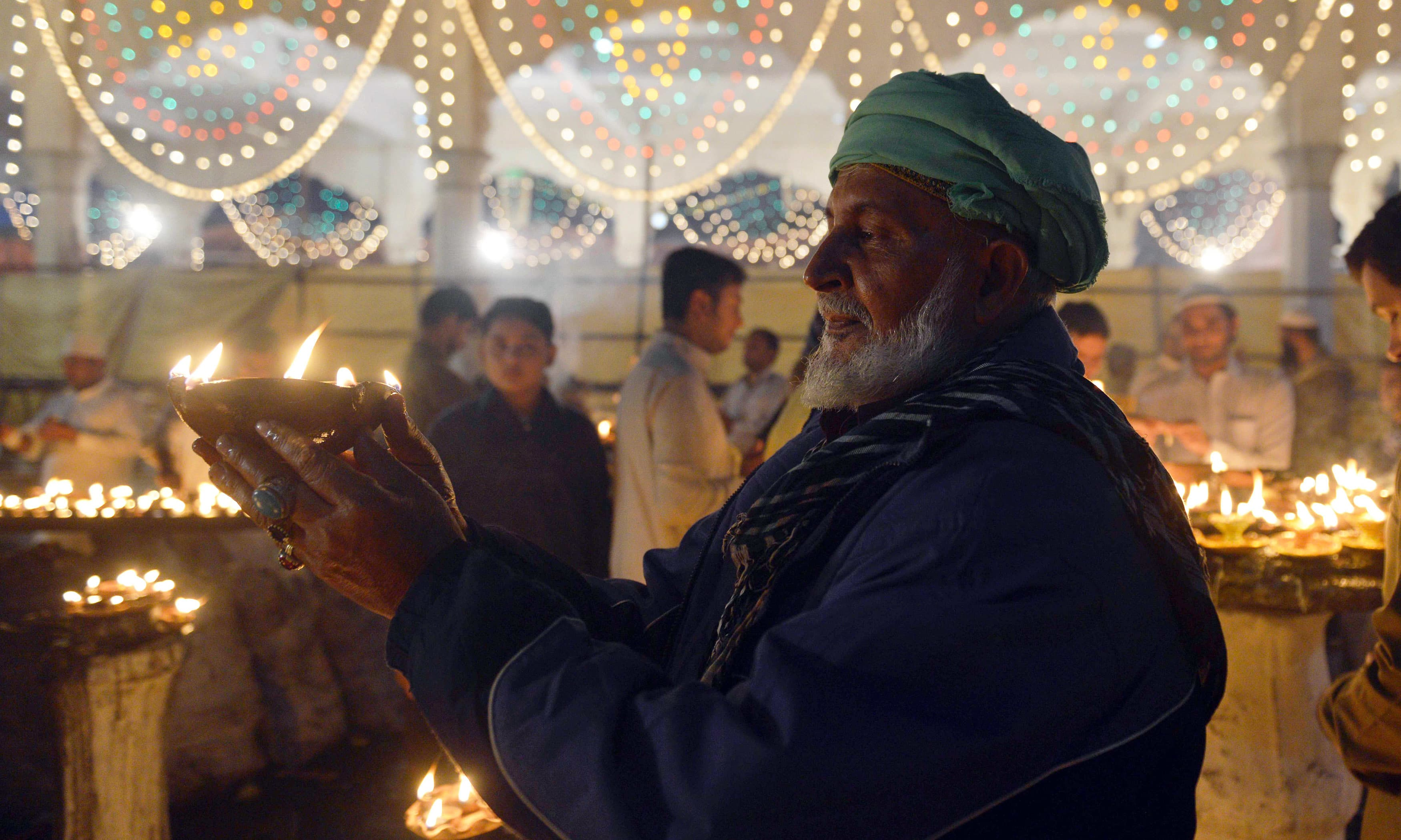 Sufi followers light incense and candles at shrine of Saint Syed Ali bin Osman Al-Hajvery, popularly known as Data Ganj Bakhsh, during the three-day annual 'Urs'.─AFP