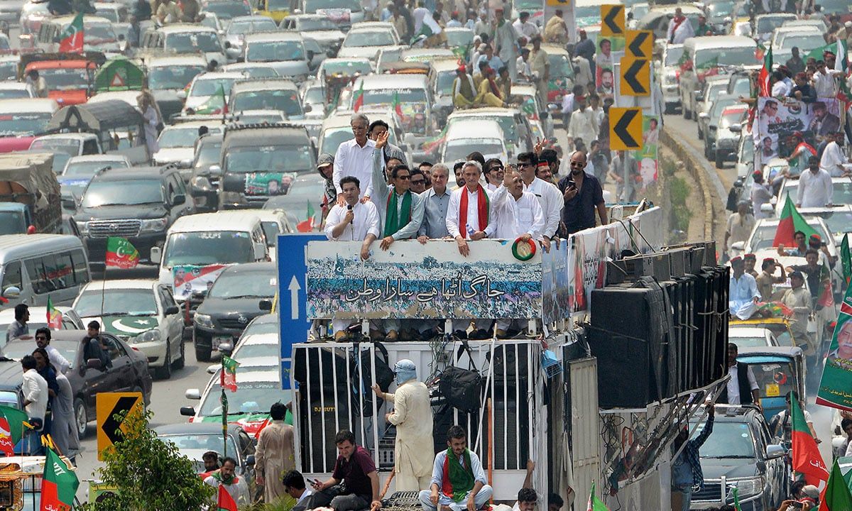 Imran Khan waves at party workers from atop a container in Peshawar | Abdul Majeed Goraya, White Star
