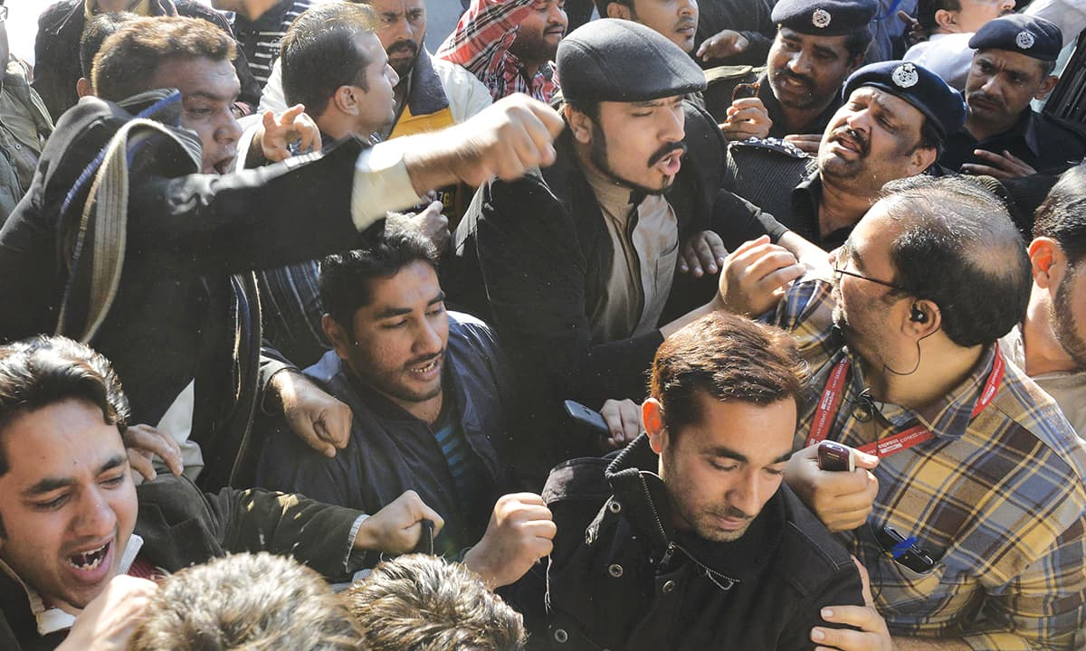 A scuffle between PTI and PMLN workers outside the provincial election commissioner's office in Lahore | M Arif, White Star
