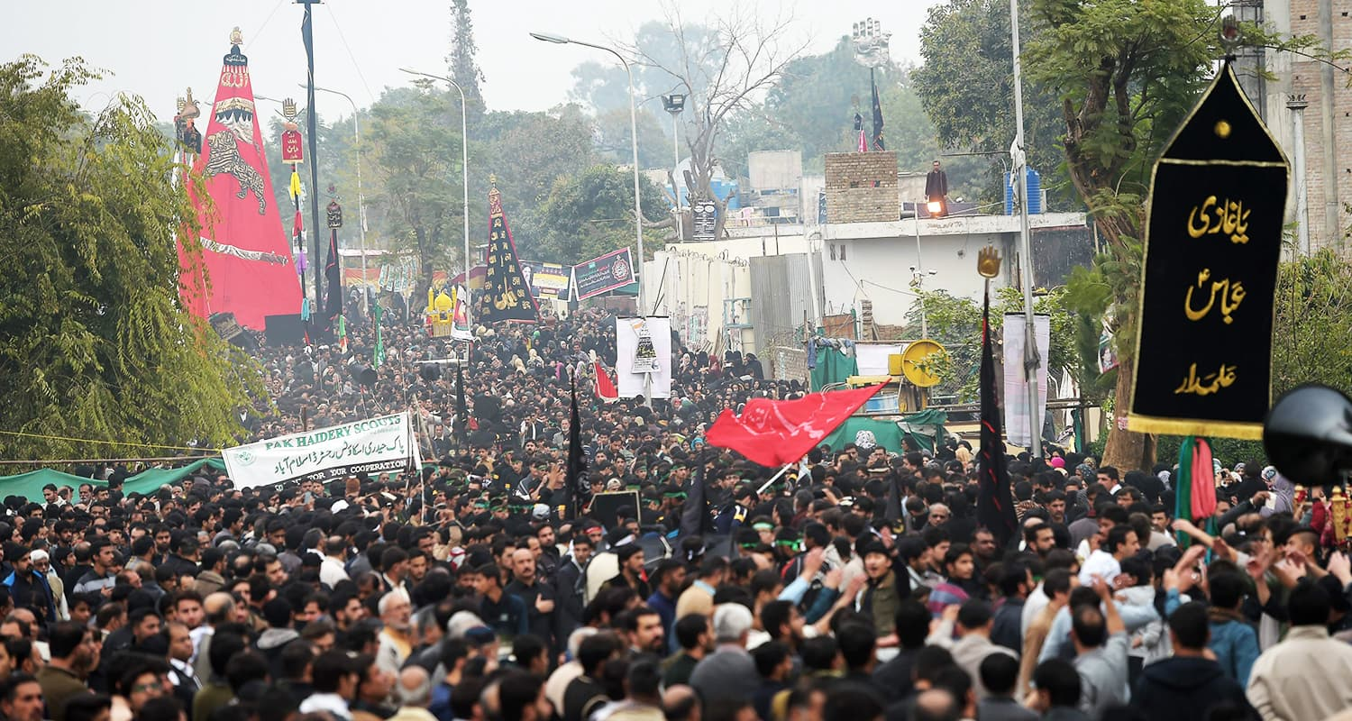 Thousands of devotees take part in the Chehlum procession. — AFP