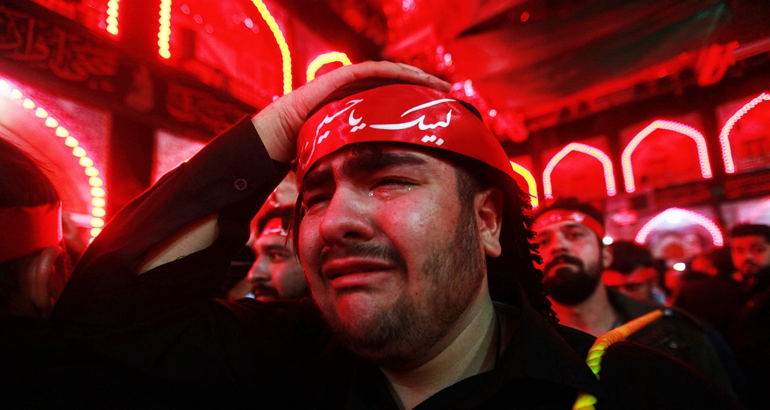 A man cries during the Chehlum rituals at Karbala. — Reuters