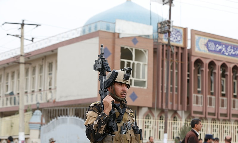 Afghan security forces keep watch in front of a mosque where an explosion happened in Kabul. ─ Rueters