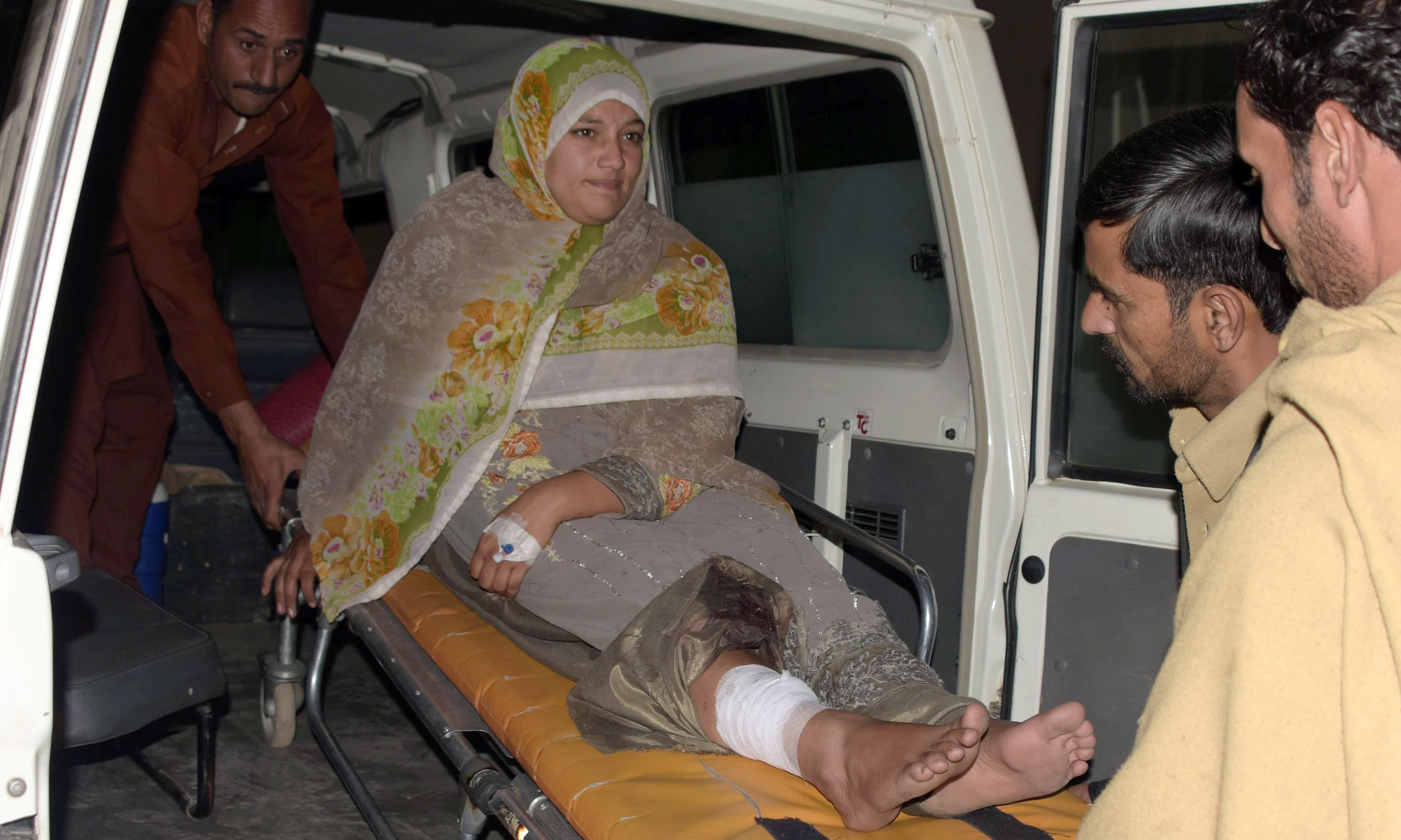 Workers shift an injured Kashmiri woman wounded in cross-border firing by Indian forces. —AFP